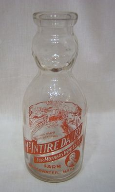 1 quart Bridgewater Dairy, Massachusetts with fabulous shape of a baby's face on the top section of the bottle! awwwesome graphics of Guernsey cows too! Milk Jars, Old Milk Bottles, Vintage Milk Bottles, Antique Bottles, Bottles And Jars, Baby Bottles, Glass Jars, Mason Jars, Guernsey Cow