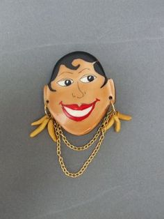 French vintage phenolic Josephine Baker brooch, complete with necklace and banana earrings.