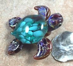 Baby sea turtle necklace glass beads pendant Handmade custom jewelry Lampwork beads Glass flowers Boro beads by RyanJesseeglass on Etsy https://www.etsy.com/listing/217773722/baby-sea-turtle-necklace-glass-beads