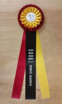 Deluxe Champion Award Rosette Ribbon - McLaughlin Ribbon Awards - Custom Award Ribbons - Custom Ribbons - Award Ribbon Rosettes - Ribbons - Custom Neck Sashes - Custom Badges and Buttons Ribbon Rosettes, Ribbons, Blue Ribbon Award, Custom Awards, Athletic Events, Custom Badges, Custom Ribbon, Dog Show, Text Color