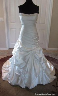 Essense of Australia D1231: buy this dress for a fraction of the salon price on PreOwnedWeddingDresses.com