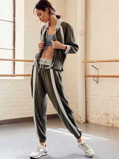 All Star Jogger | Feel like an all-star in these incredibly soft and irresistibly comfy joggers perfect for everyday wear. The classic style features a modern update with satin accents throughout. Adjustable drawstring waist creates an easy fit. Side pockets. Effortless elastic cuffs.