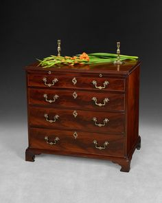 Beautiful small Chippendale period Mahogany chest of drawers with original handles and pull out brushing slide. The handles are the same as those used by Chippendale himself on the Padouk and Gilt Bookcase at Dumfries House. Ca. 1760