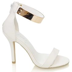 White heels with gold ankle cuff.