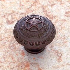 Bronze star door knob. Get rid of your boring door knobs and make or get awesome ones. YES!  http://www.bellacor.com/productdetail/jvj-hardware-41512-old-world-bronze-1-3-8-inch-texas-star-knob-191294.htm