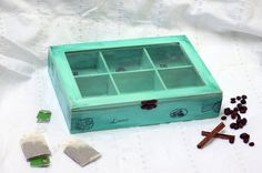 Welcome to my store!    This beautiful box have 6 sections above under clear glass. You can use it for Jewelry, different items or can use it as