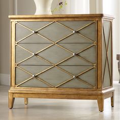 Hooker Furniture Melange Paxton 3 Drawer ChestThe soft, muted green finish on the Paxton chest is accented by a crisp pattern in gold trim for an updated take on shimmering neutrals.