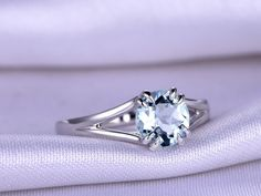 Custom handmade aquamarine engagement ring with diamonds,white/rose/yellow gold.The gemstone can be replaced with Morganite,Moissanite, Aquamarine, Amethyst,Emerald,Sapphire,Blue Topaz,White Topaz,Pink Tourmaline,Green Tourmaline,Garnet,Ruby,Peridot,tanzanite,tsavorite...or any gemstones you want,just contact me!Details about this jewelry:Material: Solid 14k Gold( White/Rose/Yellow gold available,14 &18k available)Main stone: 1.35ct 7mm Round Cut Natural Blue Aquam...
