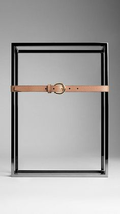 Dark sand Grainy Leather Belt - Slim belt in grainy leather with equestrian-inspired polished metal buckle.  Hand-painted edges and stitch detail.  Nubuck leather lining.  Discover more accessories at Burberry.com