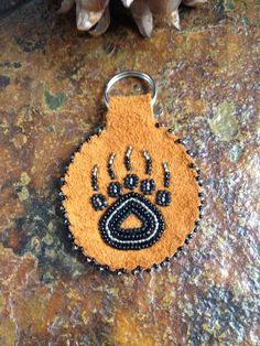 A personal favorite from my Etsy shop https://www.etsy.com/listing/289489443/bear-paw-print-key-chain