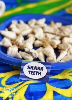 Bugles snacks, dipped in melted white candy/chocolate .... Shark Teeth Snack for a Shark Party. Thank you, Britni Huggins!