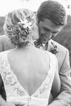 I love being able to see the grooms face! And this also gets the shot of the hair and the dress! Triple awesome ha ha