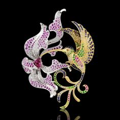 Pendant from the collection Birds of paradise. 18K yellow and white gold, tourmaline, diamonds, black diamonds, blue sapphires, pink sapphires, tsavority, demantoids.