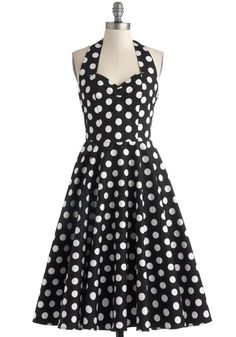 "Fit-n-flare halter dress with large polka dots and shirred back. 36"" long. $88."