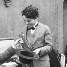 1919 - Charlie Chaplin shows the Bishop of Birmingham how he gets into his tramp persona.
