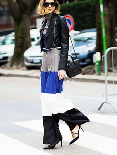 Black cropped leather jacket worn with colorblock palazzo pants