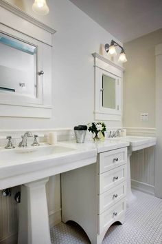 In the guest bath, twin pedestal sinks flanking a narrow chest of drawers and recessed medicine cabinets are space-efficient period elements. Tub To Shower Remodel, Diy Bathroom Remodel, Bathroom Ideas, 1920s Bathroom, Boy Bathroom, Bathroom Organization, Houzz Bathroom, Paris Bathroom, Budget Bathroom