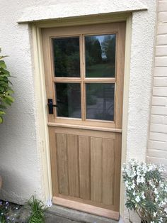 Handcrafted Oak stable door with four panes (glass not included). These beautiful doors are handcrafted. Suitable for both internal and external use. Price is for door only. Can be fitted with either single or double glazing up to thick units. Hardwood Front Doors, Oak Front Door, Wooden Back Doors, Front Porch, Cottage Front Doors, Cottage Door, Cottage Style Doors, Cottage Exterior Colors, External Doors