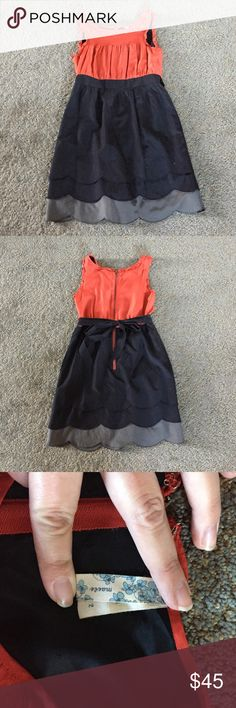 Anthropologie Maeve burnt orange and black dress Gorgeous dress! Burnt orange silk top, cotton scallop trimmed bottom in two layers of black and one grey. Bow tie in back. Pockets!!! Anthropologie Dresses Mini