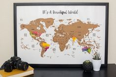 Ships within 1 business day with free domestic first class shipping!  - Scratch Your Travels™ with this gorgeous original watercolor scratching off map! Bright, bold & interactive wall art that will fit any 30 in x 20 in size frame. Use a coin to scratch off the foil to reveal the bright colors of the countries youve visited. Comes packaged in a sleek contemporary tube for easy gifting or storing. Makes a great gift for people who love to travel! - Framable: Fits any store bought 30 x 20…