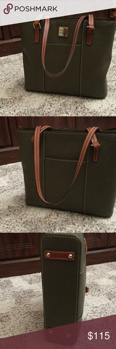 """Dooney Lexington shopper Pebble leather, double straps, metal-plated logo, four bottom feet, top zipper closure, front and back slip pockets Lined interior, two front-wall slip pockets, one back-wall zip pocket, one back-wall slip pocket, key keeper Measures approximately 12""""W x 10-1/4""""H x 3-1/2""""D with an 11"""" strap drop; weighs approximately 1 lb, 9oz Body/trim 100% leather; lining 100% cotton or 65% polyester/35% cotton. Color is Olive Green Dooney & Bourke Bags Shoulder Bags"""