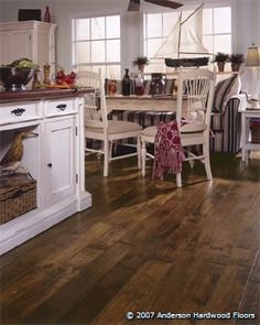 Dark hickory floors and light cabinets