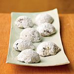 Cherry-Pistachio Wedding Cookies Recipe | MyRecipes.com, Cooking Light, 86 calories each  The combination of tender cake flour and sturdy all-purpose flour produces delicate cookies. The dough will be crumbly after you've combined all the ingredients but will hold its shape once molded in a tablespoon measure and turned onto a baking sheet. You may need to add one to two additional teaspoons of ice water to the dough to achieve the crumbly consistency.