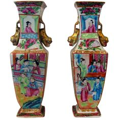 19th Century Pair Chinese Famille Rose/Canton Painted Vases  China  c.1870  Very Fine pair of small antique chinese export porcelain vases, each brilliantly handpainted with alternating reserves of beauties in palace settings, the sides with floral baskets and peacocks within gilt key border, stylized gilded dolphin handles.