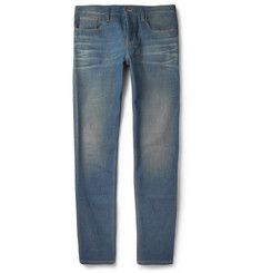 GucciSlim-Fit Washed Jeans.  470