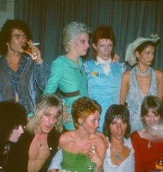 Party following David Bowie's Ziggy Stardust retirment concert, Cafe Royal, London, 4th July 1973. L-R (back) unknown, Angie Bowie, David Bowie, Bianca Jagger (front) Maureen Starkey, Mick Ronson, Lulu, Jeff Beck, Celia Hammond. Credit: Mark and Colleen Hayward