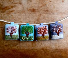 'The Four Seasons' Hand Embroidered Seasons Garland by Aly Parrott ~ Each season is created with wool felt, natural wool fibers and meticulously embroidered with cotton floss ~ ♥ Felt Embroidery, Embroidery Stitches, Embroidery Patterns, Textile Jewelry, Fabric Jewelry, Jewellery, Textiles, Broderie Simple, Wool Applique