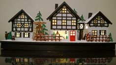 WeRChristmas LED Village Scene Christmas Decoration, Wood - Hand Painted 37.5cm. Lights On