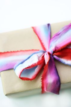 Melissa from the Sweet Escape shows you a really easy way to make stunning dip dye ribbon to make your gifts extra special.