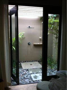 I really appreciate this design and I think with an extra side door on the outside wall it can be accessible from the pool / spa deck. Image found on Beach Chic Design: Outdoor shower