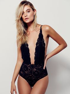 Comin' In Haht Bodysuit | Sultry lace bodysuit featuring a plunging neckline and sweet scalloped trim. Elastic waistband and adjustable straps for an easy, effortless fit.