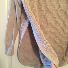 Francesca's Quinn Hi Lo Side Slit Sweater REDUCED//Cozy knit crew neck sweater in an oatmeal color purchased just a few months ago. There are a couple little picks in knit that I never noticed until inspecting to sell. (One on front, one in back)...size Large but would be cute for oversized look on smaller girl as well. Long enough to cover bum in back for wear with leggings! Francesca's Collections Sweaters Crew & Scoop Necks