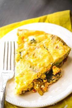 It's SO good! A lightened-up, healthy crustless veggie quiche with cheesy, broccoli, onion, and cilantro!