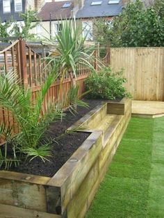 Raised flower bed with built in bench made of recycled lumber