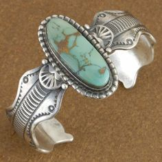 Royston Turquoise Sterling Silver Cuff Bracelet by Native American artist Leo Dawes. via Alltribes
