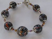 """$25.00 Butterfly Bead Bracelet - made with my own handmade butterfly  wing polymer clay beads in copper and silver metal clay.  Silver  tone hook and bead caps.  Approximately 8-1/2"""" long. The  largest bead is 3/4"""" in diameter.  See Necklaces for matching  necklace."""