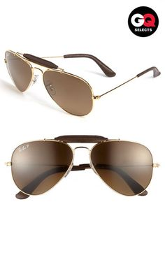 """""""The iconic Ray-Ban aviator frame style holds true to the classic we love so much, like the gradient brown lenses, but with added luxe touches like leather accents on the brow bridge and temple arms. It's a style that continues to conjure up images of McQueen and Newman in their respective heydays."""""""