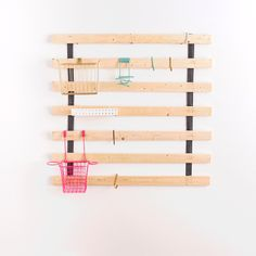 Save this easy DIY IKEA hack to repurpose bed slats into a small space hanging organizer.