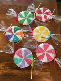 Candy made with painted paper plates wrapped in plastic for candyland themed birthday party candy land Office Christmas Decorations, Candy Decorations, Winter Decorations, Holiday Decor, Candy Land Christmas, Christmas Crafts, Christmas Door, Simple Christmas, Handmade Christmas