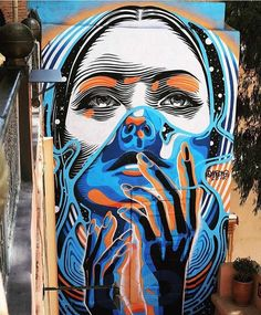 dourone-street-art-23 - A selection of the street art creations of Dourone, a Spanish artist who started in 1999 in the streets of Madrid, and who since 2012 forms a duo with his companion Elodieloll. With their slogan Art for Humans, this duo of street artists travel the world to create impressive and monumental murals, always centered on humanity, respect, tolerance and sharing