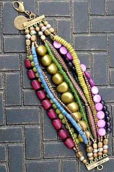 Purple, Blue and Copper Multi-Strand Beaded Cuff Bracelet                                                       like the ending of the strands into clasp