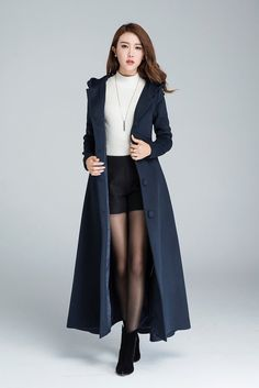 **DETAILS** * made from navy wool blend fabric (50% wool) * hooded coat * single breasted front with button closure * diagonal pockets to the hips * regular or over sized fit * Full lining * Dry clean only SIZE GUIDE  Available in women's US sizes 2 to 18, as well as custom size and plus size.  Size chart PDF https://img1.etsystatic.com/117/0/7768512/icm_fullxfull.88761713_kppuw4pg028c0wso0ckk.pdf  PHOTO https://img0.etsystatic.com/106/0/...