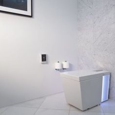 With everything from ambient colored lighting to wireless music sync capability, the Numi toilet quickly becomes the centerpiece of the bathroom. Bathroom Renovations, Bathrooms, Powder Room, Toilet Paper, Centerpieces, Contemporary, Simple, Master Bath, Color