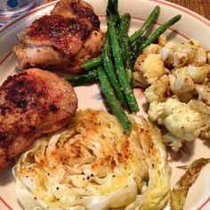 Dinner was so yum tonight! Grilled chicken thighs that were marinated in @tessemaes zesty ranch with a side of roasted green beans, cauliflower, and cabbage in @omgheebutter! This was seriously so good! My tummy is happy!