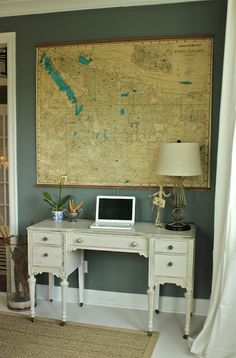 Corner desk area with vintage map art