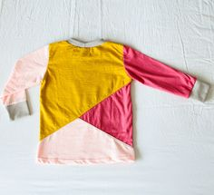 A geometric shirt for a toddler, made of some leftover pieces of fabric.